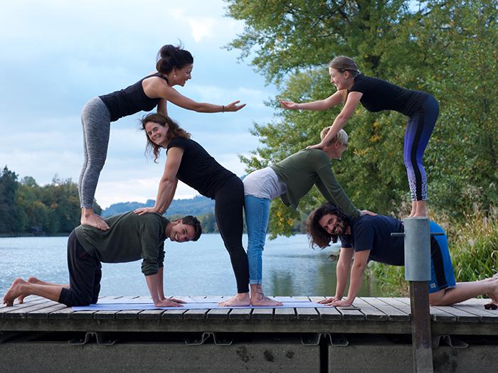 Acrobatic Yoga Beach Pose and Pyramide Handshake